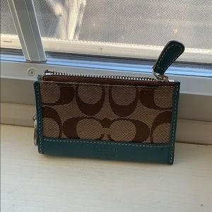 Coach credit card holder.